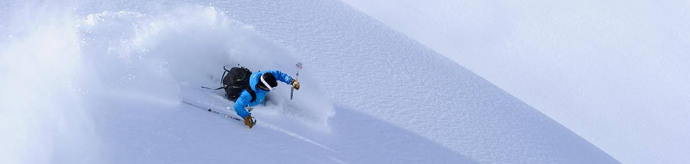 Skiier hitting powder on Steamboat mountain in Colorado